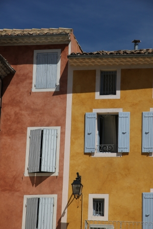Colored houses with plastered facades in Nyons, France photo
