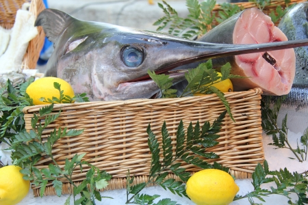 Swordfish, decorated with lemons at a market in France photo