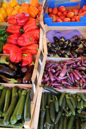 Various sorts of vegetables at a market stall in the Provence, France photo