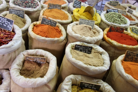 Herbs and spices in jute bags at a Provencal market in France