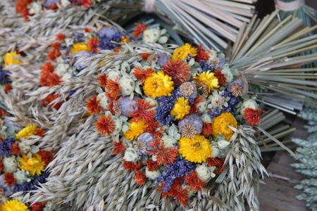 Dried lavender and wheat bouquets, for sale at a local market in the Provence, France photo