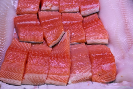 Wild salmon filets on ice in a fish shop photo