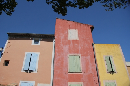 roussillon: Colored houses in the village of Roussillon, France Editorial