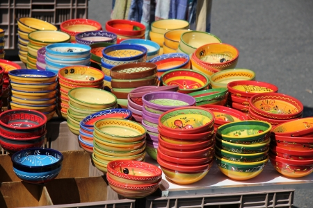 Traditional pottery on a local market in the Provence, France photo
