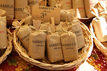 Herbs and spices in paper bags at a Provencal market in France photo