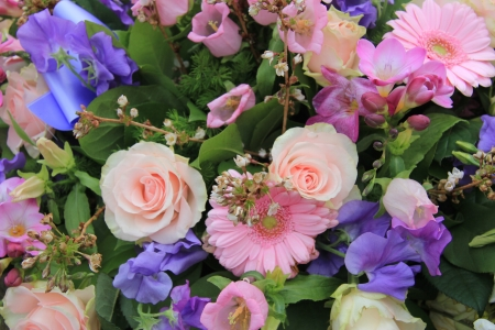 Various flowers in a mixed pink floral arrangement
