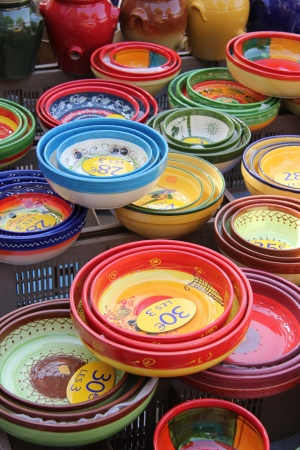 Bowls in different sizes and patterns at a Provencal market in France photo