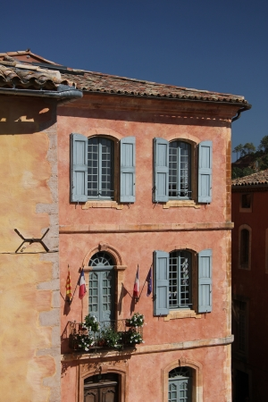 roussillon: Ochre facade of The town hall in Roussillon, Provence  Stock Photo
