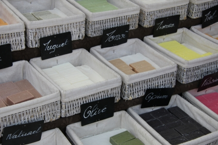 french perfume: Bars of soap in many different colors at a market in the Provence, France