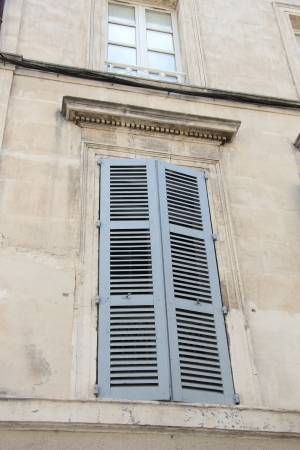 Provencal style window with painted wooden shutters photo