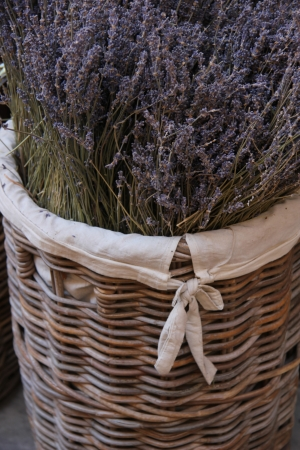 dry provisions: A wicker basket with a big bouquet of lavender