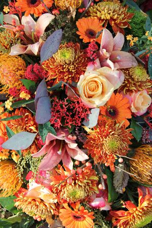 Autumn colors in a mixed floral arrangement photo