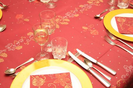 Christmas table setting on red tablecloth photo