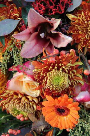Mixed flower arrangement in many autumn colors photo