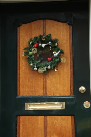 Decorative Christmas wreath on a wooden front door Stock Photo - 17204430