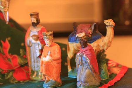 Vintage nativity scene figurines, three kings and camel Stock Photo - 17457515