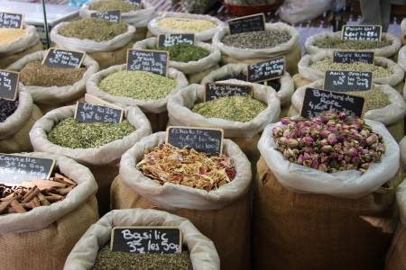 Herbs and spices in jute bags at a Provencal market in France photo