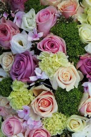 Floral wedding centerpiece in purple, pink and white photo