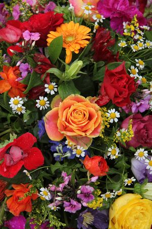Mixed floral arrangement in bright colors photo