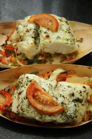 Grilled wolffish fillet with tomato and herbs photo