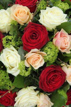 Bridal flower arrangement in red, pink and white, big roses Stock Photo - 18087195