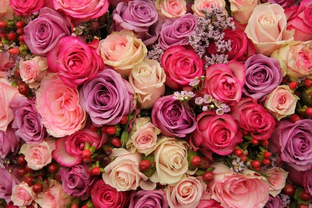 Wedding flowers: roses in various pastel colors photo