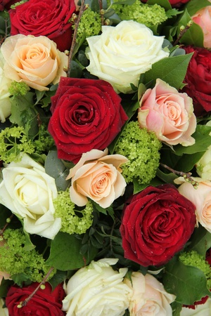 Bridal flower arrangement in red, pink and white, big roses photo