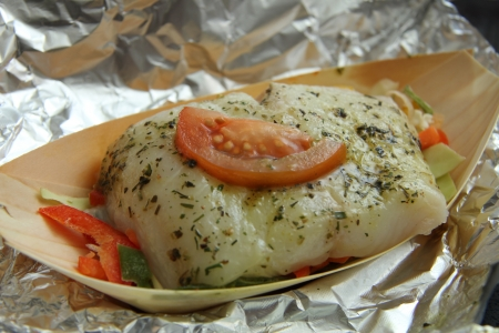 Wolffish fillet with herbs, vegetable and tomato, ready to put in the oven photo
