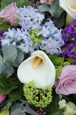 White calla lily in a blue and purple wedding arrangement photo