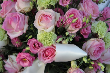 Pink roses and green white carnations in a bridal flower arrangement pink roses and green white carnations in a bridal flower arrangement stock photo 19224902 mightylinksfo