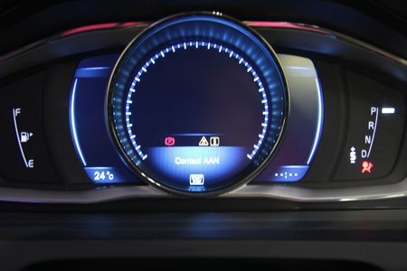 Blue lighted dashboard of a modern car photo