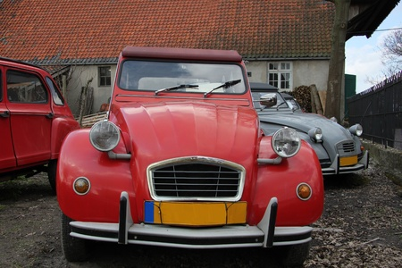 Vintage French cars in red and grey photo