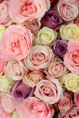 are combined: Bridal flower arrangement in various shades of pink, combined with white and purple