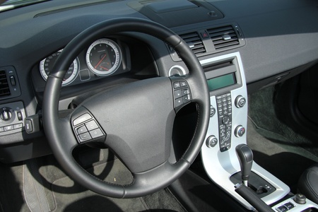 Dashboard and interior of a brand new car, leather and stainless steel photo