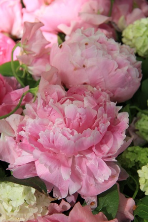 Big pink peonies in a wedding flower arrangement photo
