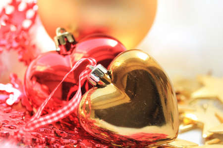 Group of red and golden christmas decorations, heart shape photo