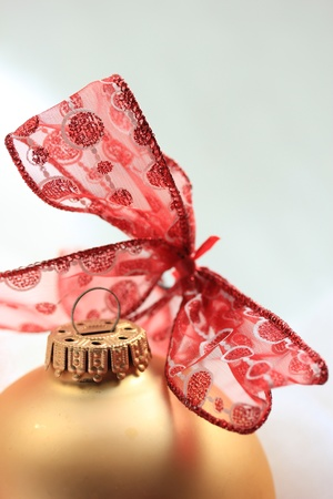 Christmas ornaments in red and gold: ornament and a bow photo