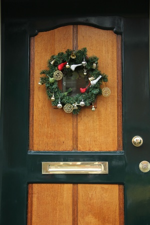 Classic christmas wreath with decorations on a wooden door photo