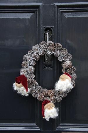 Wreath made of cones on a classic grey door photo