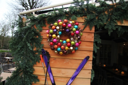 Log cabin with colorful christmas decorations photo