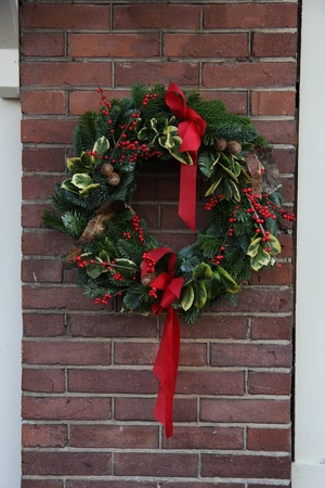 Classic christmas wreath on a brick wall photo