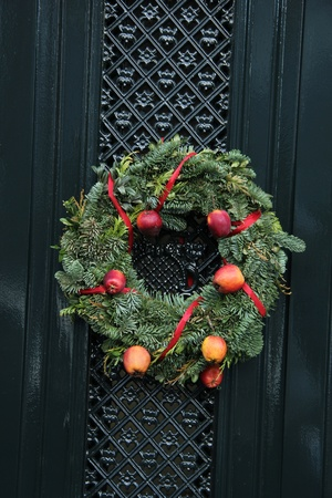 Classic christmas wreath with decorations on a door photo