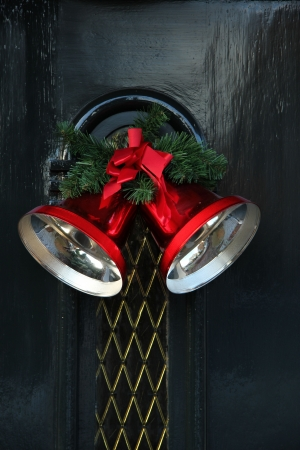 Big red christmas bells on a classic front door photo