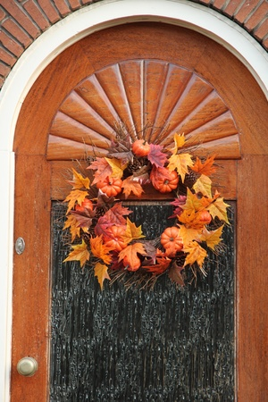 Autumn foliage thanksgiving decorations on a wooden door photo
