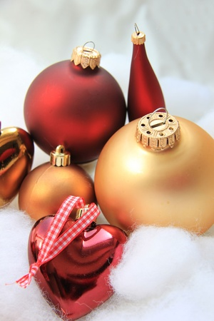 Group of red and golden christmas decorations in various shapes photo