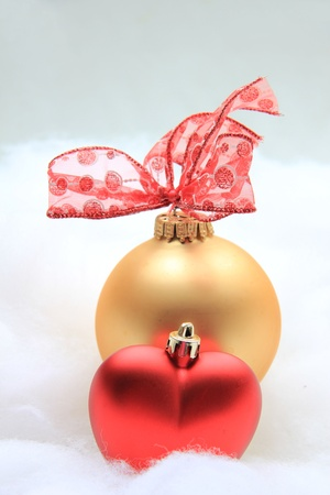 Red and golden christmas decorations, red lace bow photo