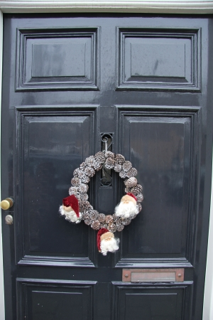 Wreath made of cones on a classic grey door photo