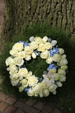 sympathy wreath with white roses and blue hydranghea
