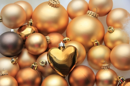 Golden christmas ornaments in various shades and sizes photo