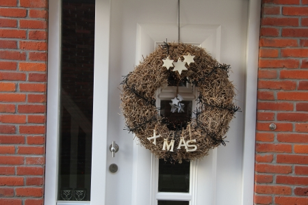 Contemporary white door with a x-mas wreath photo